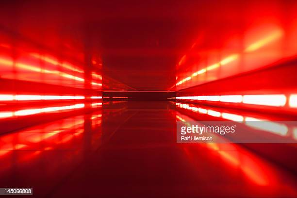 An abstract corridor in red tones