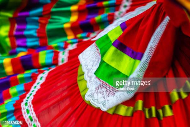 an abstract image of a traditional mexican dress in motion - folk music stock pictures, royalty-free photos & images