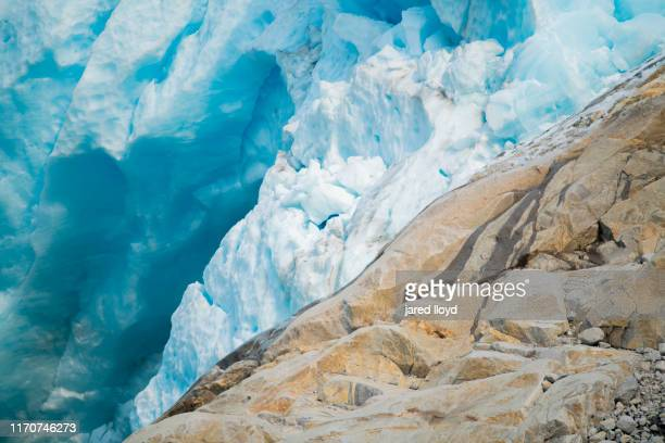 an abstract of blue ice and exposed rock from retreating glacier - golfo do alasca imagens e fotografias de stock
