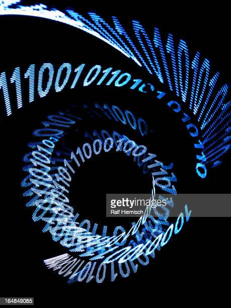 An abstract spiral pattern of binary code