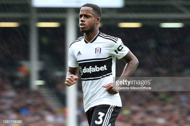 An abstract view of Ryan Sessegnon of Fulham in heavy rain during the Premier League match between Fulham FC and Watford FC at Craven Cottage on...