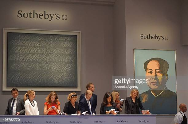 An abstract work by Cy Twombly from his 'blackboard' series fetched $705 million is seen during the Sotheby's evening sale of contemporary artworks...