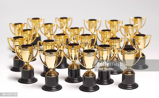 an abundance of trophies - trophy award stock pictures, royalty-free photos & images