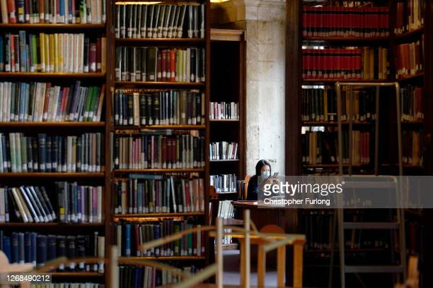 An academic studies in the Radcliffe Camera at the Bodleian Libraries on August 25, 2020 in Oxford, England. The world famous libraries closed in...