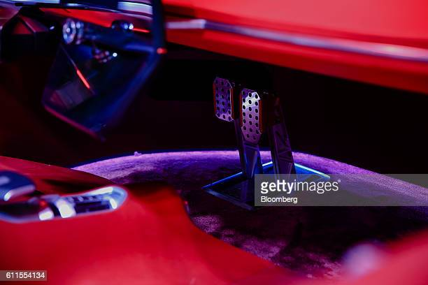 An accelerator and brake pedals sit inside a new Renault Trezor concept automobile produced by Renault SA during the second press day of the Paris...