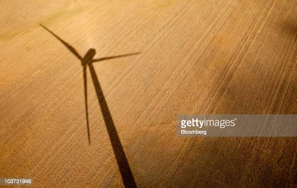 An Acciona wind turbine casts a shadow over wheat fields at the NaturEner USA LLC Glacier wind energy farm in Ethridge Montana US on Monday Aug 30...