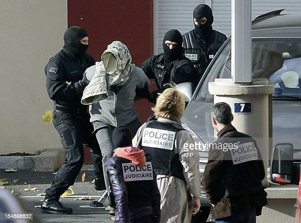 An accomplice of a top leader of the Basque separatist group ETA Joseba Iturbide is escorted by members of France's RAID antiterrorism police unit...