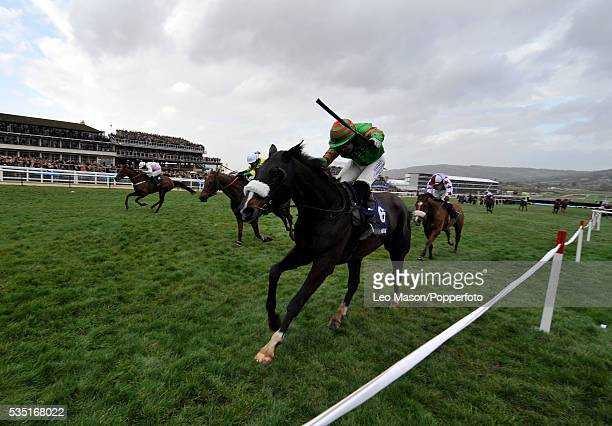 An Accordion and Tom Scudamore on their way to winning The William Hill Trophy Handicap Chase during the 2008 Cheltenham Festival in Cheltenham...