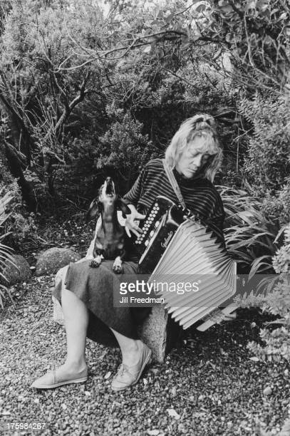 An accordion player with a canine accompanist on the Dingle Peninsula County Kerry Ireland 1988