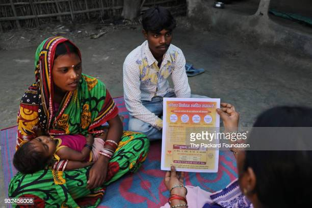 An Accredited Social Health Activist discusses family planning options with a young couple ASHAs are trained and supported by Pathfinder...