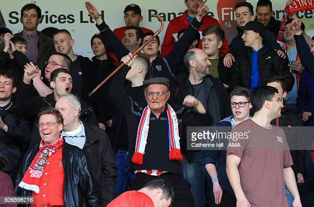 An Accrington Stanley fan dressed as an elderly man holds his walking stick in the air during the Sky Bet League Two match between Wycombe Wanderers...