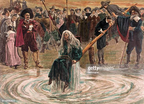 An accused witch going through the judgement trial, where she is dunked in water to prove her guilt of practicing witchcraft.
