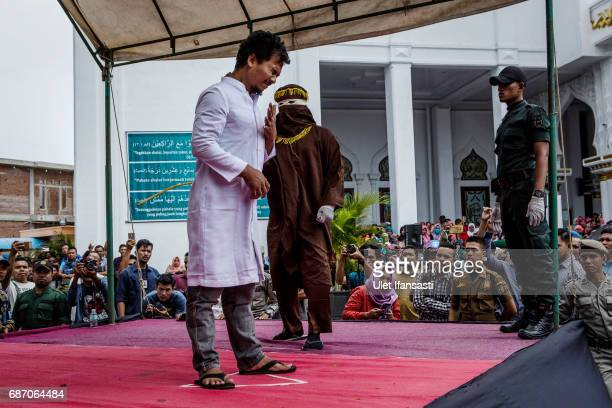 An acehnese man gets caning in public from an executor known as 'algojo' for spending time with a woman who is not his wife which is against Sharia...