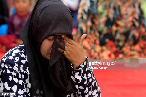 An Acehnese woman gestures during the 13th anniversary of Tsunami commemoration at Ulee Lheue Banda Aceh in Aceh Indonesia on December 26 2017 The 92...