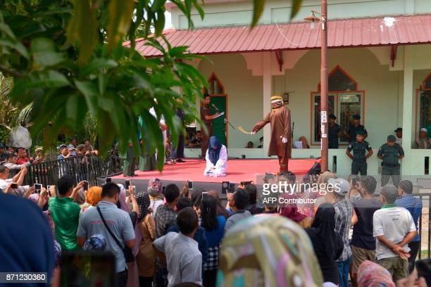An Acehnese woman is caned for committing adultery which is against Sharia law in Banda Aceh on November 7 2017 Aceh is the only province in...