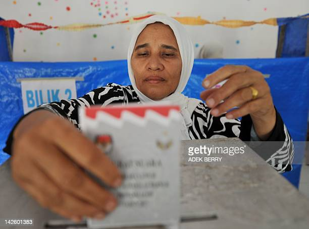 An Acehnese woman votes during the province's second election in Banda Aceh on April 9 2012 Indonesia's only province ruled by Islamic sharia laws...