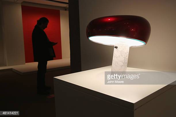 An Achille and Peir Giacomo Castiglioni 'Snoopy' lamp sits on display ahead of auction at Sotheby's November 22 2013 in New York City The lamp is...
