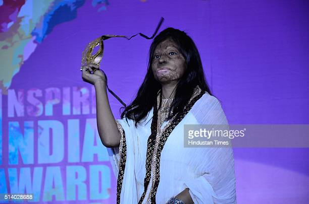 An acid attack victim taking part in a fashion show organised by Prerna NGO to mark the International Women's Day on March 6 2016 in Bhopal India The...