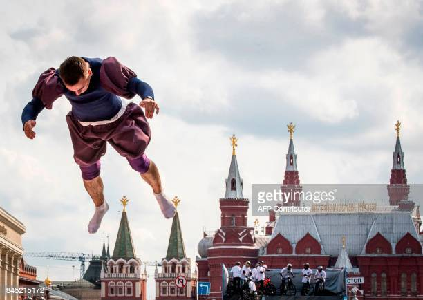 An acrobat jumps on Tverskaya street during the celebrations of the 870th anniversary of the city in downtown Moscow on September 10 2017 / AFP PHOTO...