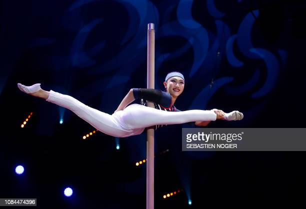 TOPSHOT An acrobat of the China National Acrobatic Troupe performs during the opening ceremony of the 43rd MonteCarlo International Circus Festival...