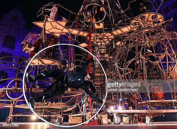 An acrobat performs at the market square in Wroclaw on January 172016 to officially mark the inauguration of the city as the 2016 European Capital of...