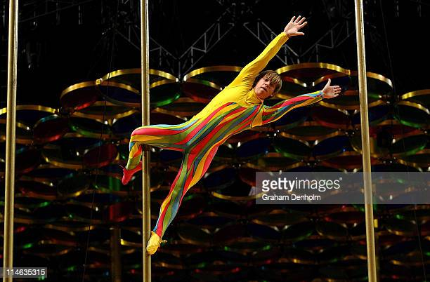 An acrobat performs during a training session and media call ahead of Cirque du Soleil's opening night performance of 'Saltimbanco' at Rod Laver...
