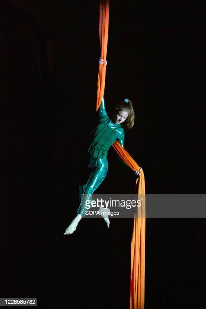 An acrobat performs on aerial silks during the Ana Desetnica street theatre festival. After a short first part of the festival in early July due to...