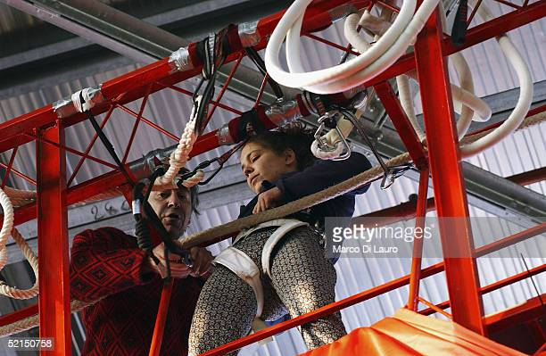 An acrobat practices for her show on a decorated float at the 'Carnival City' where floats are built on February 4 2005 outside Viareggio Italy The...