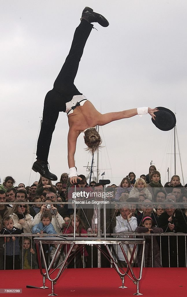 An acrobatic act performs during the Street Circus Parade during the 31st International Circus Festival of Monte-Carlo on January 20, 2007 in Monaco.