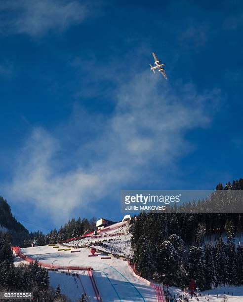 An acrobatic aeroplane flies above the Streif downhill course prior to the start of the FIS World Cup men's downhill race at Hahnenkamm in Kitzbuehel...