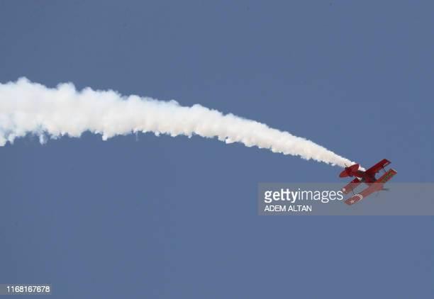 An acrobatic biplane performs during the Sivrihisar Airshow in Sivrihisar district of Eskisehir on September 14 2019