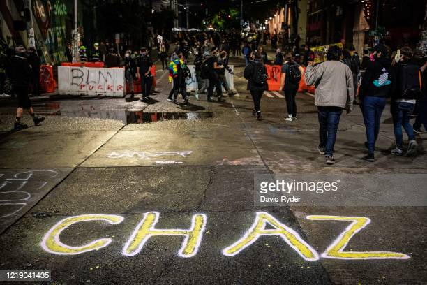 "An acronym for ""Capitol Hill Autonomous Zone"" is seen painted on the street near the Seattle Police Departments East Precinct on June 9, 2020 in..."