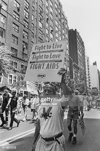 An 'Act Up' march on Fifth Avenue on the 25th anniversary of the Stonewall Riots New York City USA 26th June 1994 A placard reads 'Fight to live...