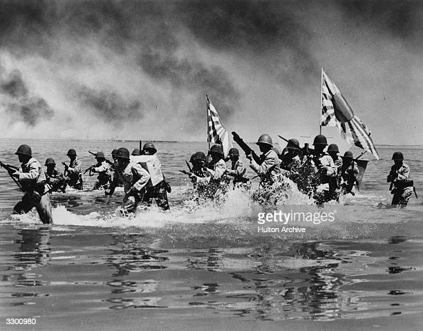 An action shot from the film 'Wake Island' where marines fight to hold an American base on a Pacific Island during World War II The film was directed...