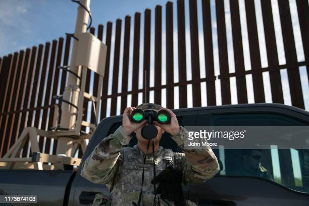 An active duty U.S. Army soldier scans for undocumented immigrants while on duty manning a high-res surveillance camera near the U.S.-Mexico border...