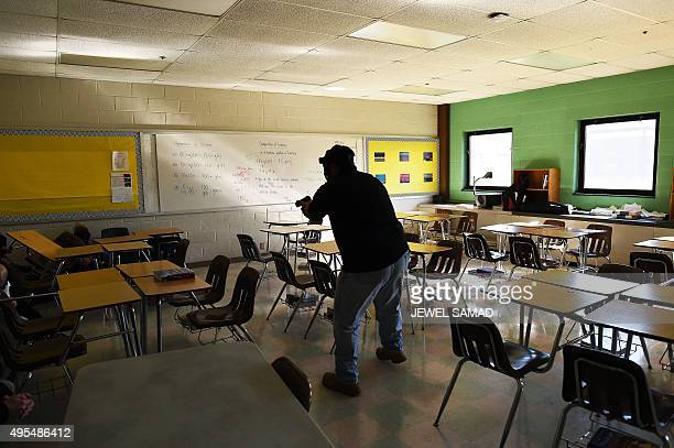 An 'active shooter' attacks a classroom during ALICE training at the Harry S Truman High School in Levittown Pennsylvania on November 3 2015 ALICE is...