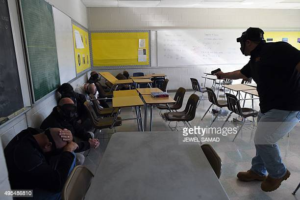 An 'active shooter ' attacks a classroom during ALICE training at the Harry S Truman High School in Levittown Pennsylvania on November 3 2015 ALICE...