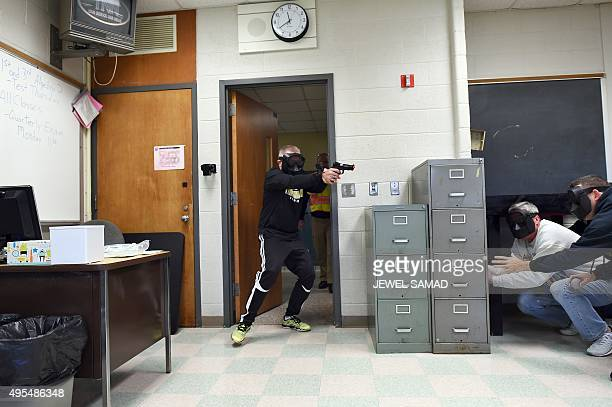 An active shooter enters a classroom as students take cover during ALICE training at the Harry S Truman High School in Levittown Pennsylvania on...