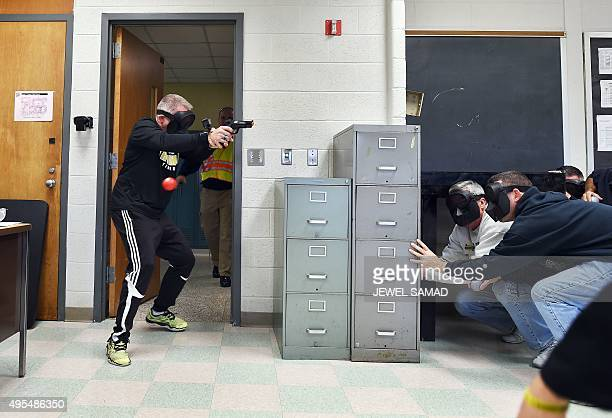 An 'active shooter' enters a classroom as 'students' take cover during ALICE training at the Harry S Truman High School in Levittown Pennsylvania on...