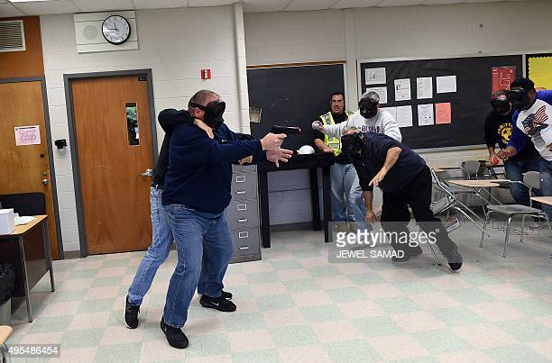 An 'active shooter' is tackled as he attacks a classroom during ALICE training at the Harry S Truman High School in Levittown Pennsylvania on...