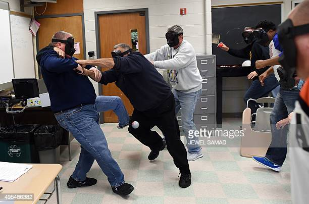 An 'active shooter ' is tackled during ALICE training at the Harry S Truman High School in Levittown Pennsylvania on November 3 2015 ALICE is...