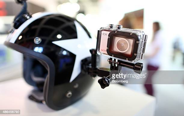 An Activeon camera sits mounted on the side of a motorcycle helmet on the company's exhibition stand during the IFA International Consumer...