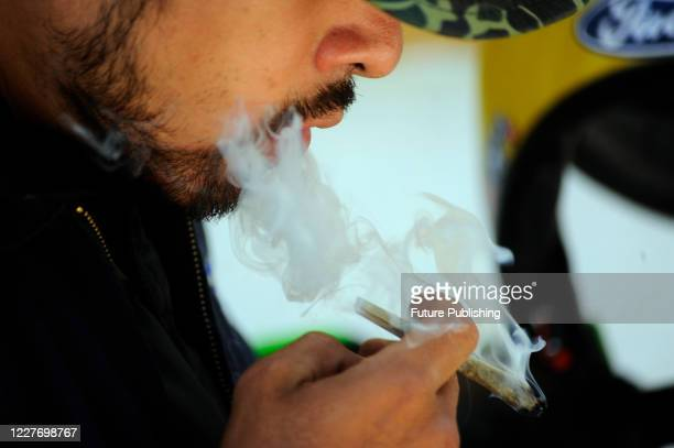 An activist a marijuana smokes during a camp outside the country's Senate building, Mexican marijuana activists have been camping outside the Senate,...