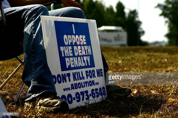 An activist against the death penalty displays his sign outside Greensville prison on September 23, 2010 in Jarratt, Virgina, just hours before the...