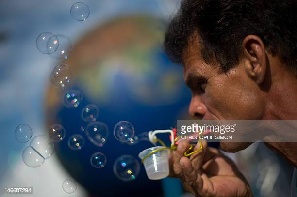 An activist blows 'ecological' sopa bubbles during last day of the People's Summit at Flamengo Park in Rio de Janeiro Brazil on 22 June in the...