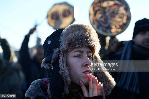 An activist celebrates at Oceti Sakowin camp on the Standing Rock Sioux Reservation on December 4, 2016 in Cannon Ball North Dakota, Colorado. The US...