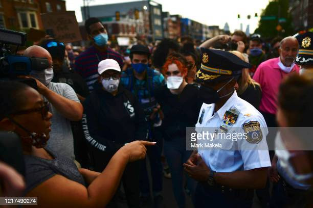 An activist confronts a police officer while gathering in protest outside the 26th Precinct on June 3 2020 in Philadelphia Pennsylvania Protests...