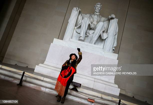 An activist demonstrates in the Lincoln Memorial during the Indigenous People's March on the National Mall in Washington DC on January 18 2019