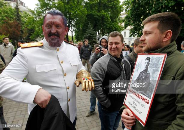 An activist dressed like Soviet leader Joseph Stalin attends a protest of Democratic Ax civil movement, holding placards depicting of World of...