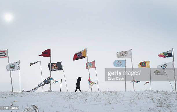 An activist fights the wind as while walking along Flag Road in Oceti Sakowin Camp as blizzard conditions grip the area around the Standing Rock...